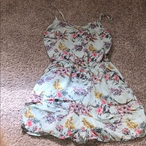 H&M floral romper with pockets and cross back